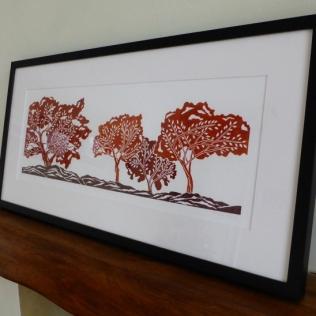 'Autumn Trees, linocut. Edition of 60. 52 x 19cm.